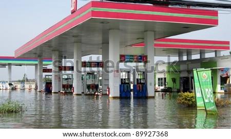 LAMLUKKA (PATHUMTHANI), THAILAND – CIRCA NOVEMBER 2011 – Flooded petrol station circa November 2011 in Lamlukka. The entire province has been flooded due to and unprecedented rainy season.