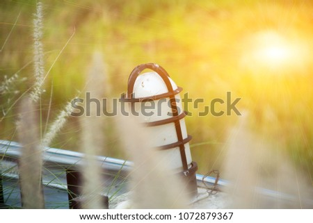 lamp and light, lamp and sun,Lamp and sunset, lamp and sunrise,lamp and grass,Thailand. #1072879367