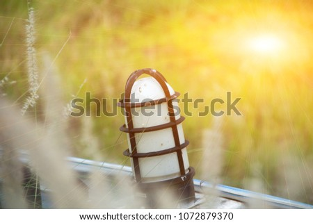 lamp and light, lamp and sun,Lamp and sunset, lamp and sunrise,lamp and grass,Thailand. #1072879370