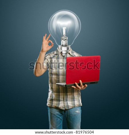 lamp-head male with laptop in his hands shows OK