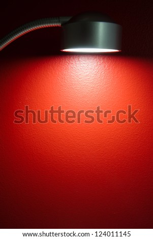 lamp illuminating red wall