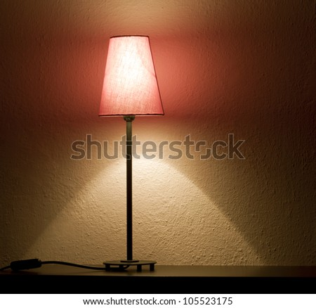 Lamp in the night on the shelf abstract background