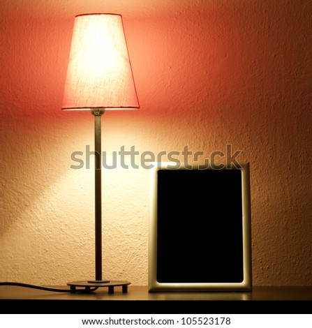 Lamp in the night on the shelf abstract background - stock photo