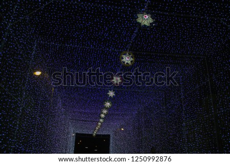 lamp of star,light of star,Tunnel of light,Star Wall in the night,Christmas festival,Christmas light,  #1250992876