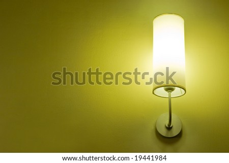 Lamp on a wall shining. Including copy space.