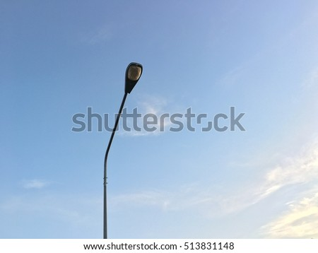 Lamp on street with blue sky. Twilight time, lamp save energy. Lamp closing light, for save energy. #513831148
