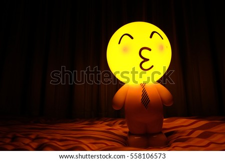 Lamp yellow round  face emoticon kiss a black background #558106573