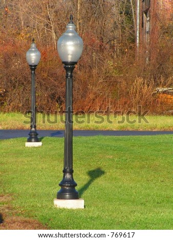 LAMPPOST AT EDGE OF PARKING LOT