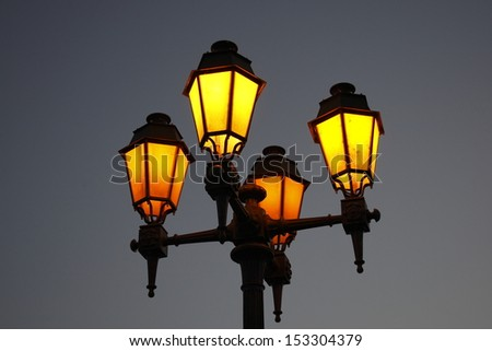 Lampposts with yellow warm light