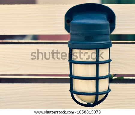 lamps at wooden fences.