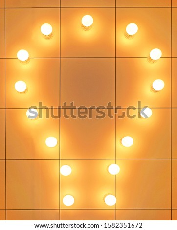 Lamps, LED lamps on wall background. Large set of LED bulbs. White energy-saving light bulbs. Light bulbs lie in a row.                                #1582351672