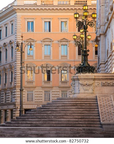 Lamps on the stairs at the back of the parliament building, Rome, Italy, beautifully lit by the first sunrays at sunset