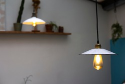 Lamps pending from the celling with vintage light bulbs in a trendy retro restaurant patio