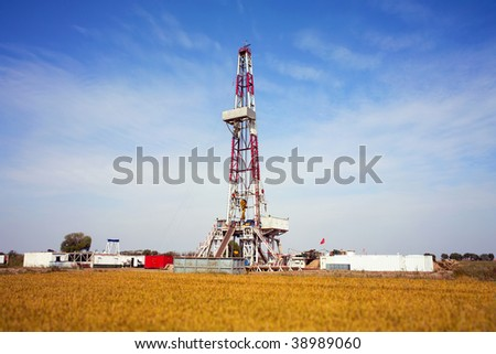 Land drilling rig surround by rice field in China