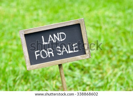 Land for sale - chalkboard with text on green grass background #338868602