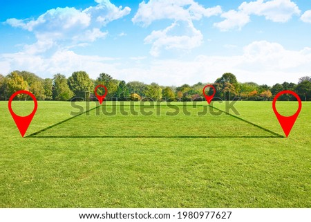 Land plot management - real estate concept with a vacant land on a green field available for building construction and housing subdivision in a residential area for sale, rent, buy or investment.