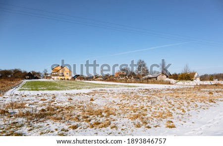 Land plot reclamation for property development. Sale at auction. Commercial building. Leveling, adding soil to the site. Land cleaning work. Winter season. Clean field area. Banner. Countryside. Farm. Stockfoto ©
