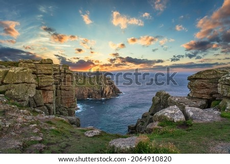 Land's End cliffs at sunset in Cornwall. United Kingdom
