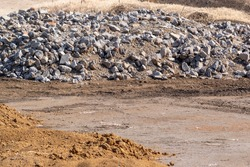 Land under construction where soil and concrete lumps are placed