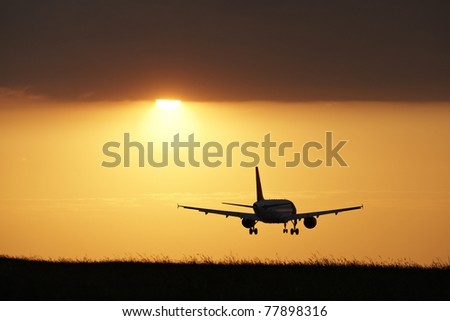 Landing at sunset, Prague Ruzyne Airport - stock photo