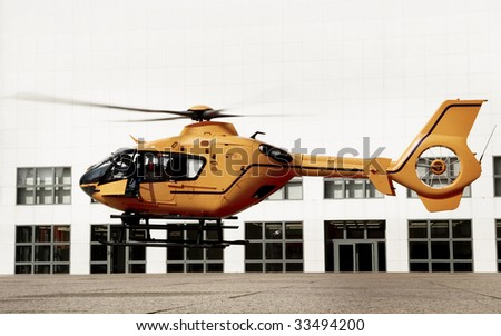 landing emergency helicopter - stock photo