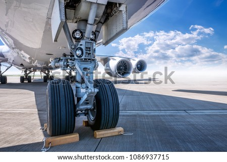landing gear of an modern airliner at the airfield #1086937715