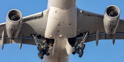Landing gear retracting on a large commercial airplane after takeoff.