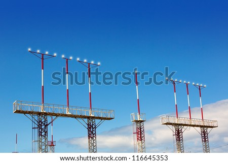 Landing lights towers in white and red over blue sky in Canary Islands