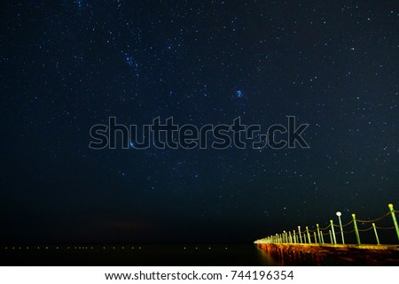 Landing stage and stars at night #744196354
