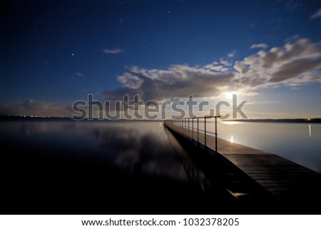 landing stage at night #1032378205