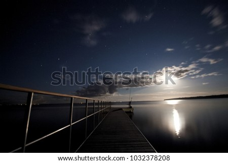 landing stage at night #1032378208