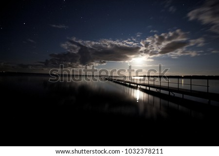 landing stage at night #1032378211