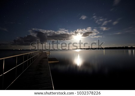 landing stage at night #1032378226