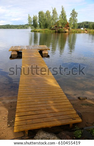 landing stage in lake in pure latvian nature  #610455419