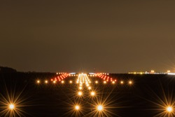 landing strip  at night with lights on