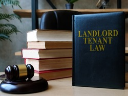 Landlord tenant law book on the lawyer desk.