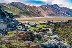 LANDMANNALAUGAR, ICELAND - JULY 6, 2018 : Tents and camping at Landmannalaugar in Highlands of Iceland with the beautiful mountain