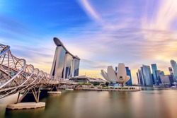 landmark modern building near river in singapore