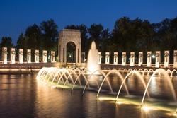 Landmark World War II Memorial fountains at the National Mall in Washington DC seen at night.