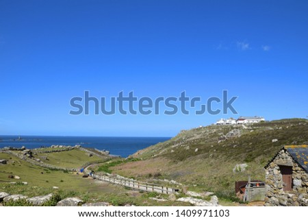 Lands End, Cornwall (UK). Picture of farmhouse + farm land set across the rolling hills and surrounded by cliffs to the sea.  #1409971103
