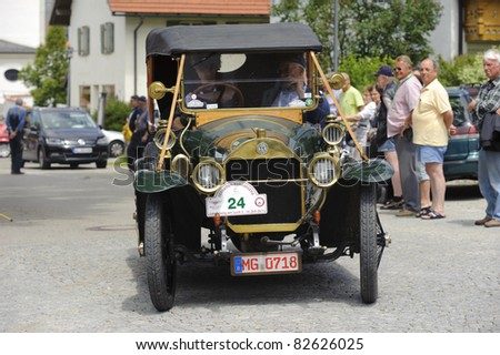 LANDSBERG, GERMANY - JULY 9: Oldtimer rally for at least 80 years old antique cars with Mercedes Benz, built at year 1912, photo taken on July 9, 2011 in Landsberg, Germany