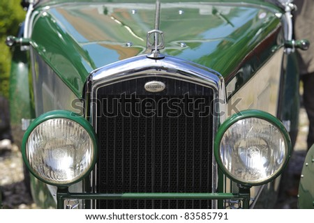 LANDSBERG, GERMANY - JULY 9: Oldtimer rally for at least 80 years old antique cars with Wolseley Hornet, built at year 1927, photo taken on July 9, 2011 in Landsberg, Germany