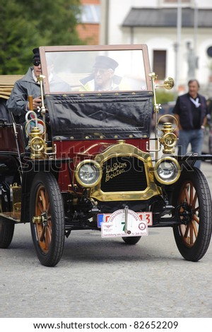 LANDSBERG, GERMANY - JULY 9:  Participants of the Oldtimer rallye for at least 80 years old antique cars with De Dion Bouton, built at year 1904, photo taken on July 9, 2011 in Landsberg, Germany