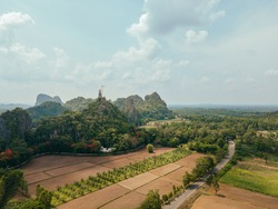Landscape agriculture nearly the mountain. Beautiful landscape buddha temple on the mountain in Thailand.