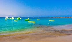 Landscape and beach promenade panorama of Playa de Las Vistas of Canary Spanish island Tenerife in Africa.