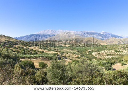 Landscape and Olive Groves in south Crete. Agriculture and Olive Groves determine the picture on the Island. In the background the Ida mountains with the Psiloritis as highest mountain on Crete.