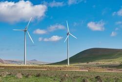 Landscape and renewable energy wind turbines on the island of Lanzarote, Canary Islands, Spain