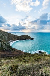 Landscape at sunrise over the Nez de Jobourg from the cliffs on the edge of the Channel (Normandie, France)
