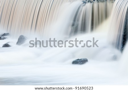 Landscape captured with blurred motion of a cascade on the Rabbit River, Michigan, USA