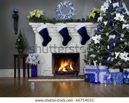 Landscape Christmas background with blue tree and decorations around fire.